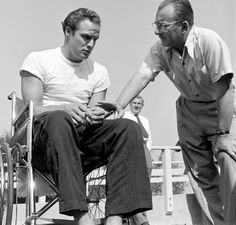 Marlon Brando chats with a production manager while training for his role in <i>The Men</i>, 1949.
