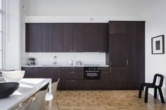 Light flooded home with a dark kitchen  - via Coco Lapine Design blog