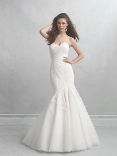 Lovely lace makes for a beautiful walk down the aisle in the Allure Bridals Madison James MJ17 wedding gown. Intricate lace of swirling paisley with free form daisies...