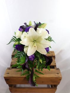 Small wedding cascade in whites and purples. Including Calla lily's, Lily's, lissianthis and ferns. Designed by Florist ilene, Hamilton, NZ Flowers Delivered, Calla Lily, Corsage, Ferns, Gift Baskets, Hamilton, Wedding Bouquets, Beautiful Flowers, Great Gifts