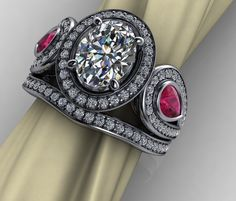 Warwick Jewelers custom design. 2 piece diamond/ruby ring. Come in for a free design consultation.