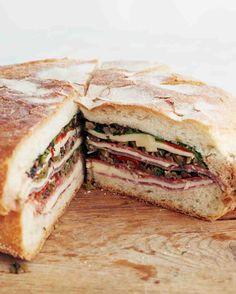 Muffaletta ***  Notes:  3 slices mortadella (slices are size of bread), 16 slices of hot soppressata, 6 slices of finocchiona salami, 6 slices fontina cheese, 4 slices provolone cheese, 7 slices coppa