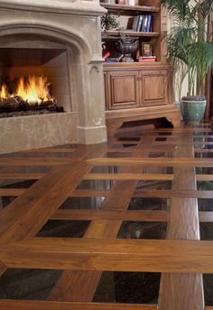 Walnut flooring with tile inlays.