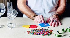 Make letters out of beads using the bead template and use ribbon to attach them to glasses to decorate the table.
