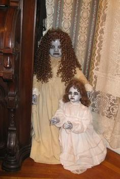 Broken doll??? No problem. Dress um up. Halloween's a coming ;)