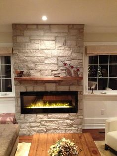 Electric fireplace with natural stone & barn beam mantel traditional