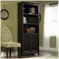"Library Bookcase with Doors $129.99 Three adjustable shelves Hidden storage behind doors Classic black finish 29-1/4""W x 13""D x 71-7/8""H SKU(s): 810256431 In Store Only"