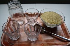 spoon rice first into three glasses, then spoon from glasses into jar, finally pour jar contents back into bowl. Will require just right glasses and jar sizes Montessori Materials, Practical Life, Kindergarten, Activities, Diy Toys, Contents, Spoon, Glasses, 1 Year