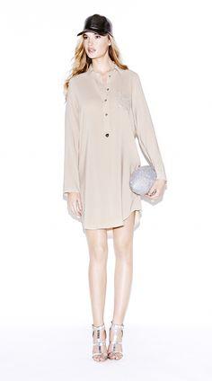 Model wears Naughty Dog silk blouse-dress with Swarovski elements on the pocket.