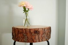 A simple log becomes a charming nightstand with the help of some grafted legs from a stool.