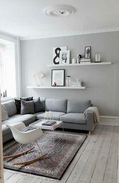 Living room decor ideas  grey walls  gray walls  white floating shelves  grey sofa  interior decoration