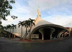 Saint Andrew the Apostle Church - is one of the known Modern Edifices designed by Leandro V. Locsin in Makati City. The butterfly shaped floor plan emanates from this cruciform. Andrew The Apostle, Filipino Architecture, Shell Structure, Makati City, St Andrews, Patron Saints, Roman Catholic, Bel Air, Philippines