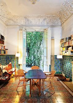 a tiled room with French doors, perfect for bookshelves