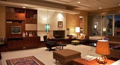 """<b>Draper apartment</b> (1966, inspired by Frank Lloyd Wright): """"Don's moving from suburbia—from classical and neoclassical architecture to modern...The sunken living room creates a more dynamic space for the actors. Sometimes they have to step over furniture to get into that lower level. It's fun."""" —Dan Bishop, set designer"""