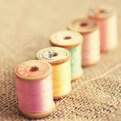 still life photography pink art vintage thread spool art sewing decor yellow blue home decor burlap All in a Row 2
