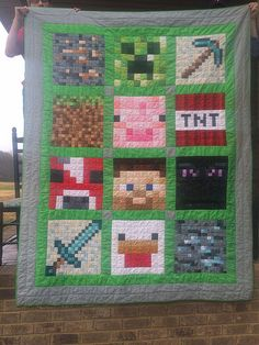 This is a quilt, but you could probably make it with crochet or knitted squares too.