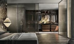 Zenit walk-in closet with brown aluminum uprights, castoro regenerated leather and coal larch melamine accessories.