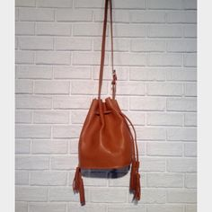 "HPStreet Level Faux Leather Bucket Bag Colors: burgundy, tan and grey. faux Leather. Drawstring closure. attached snap-front wallet. adjustable cross body strap. 9"" W x 12"" H x 7"" D. MAKE ME AN OFFER!  Street Level Bags Crossbody Bags"
