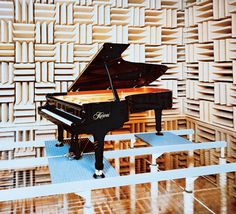 """A photo taken inside the anechoic chamber at our research facility in Ryuyo, Japan. An anechoic chamber has no sound reflection and therefore doesn't """"color"""" or alter the sound of an instrument placed inside. This allows the acoustic piano engineers hear the pure sound of the instrument.  The anechoic chamber was also used by our Electronics R&D team when the original Harmonic Imaging sound technology was developed.  #Kawai #pianos #acoustic #anechoic #instruments #sound #technology"""