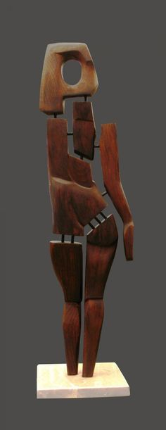 Wood. metal. stone Sculptures of females by artist David Sirbiladze titled: 'Lady in Wood (Upright Standing Naked Woman Carving abstract statues)'