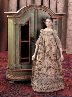 Early 19th Century All-Wooden Doll with Charming Facial Expression and Rare Carved Hair. Circa 1810. http;//Theriaults.com