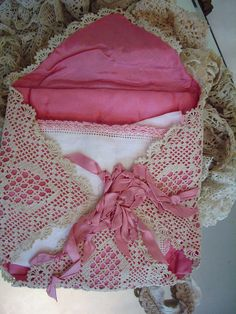 Use lace or embroidered hankys, line with satin and make into an envelope to store love letters and such