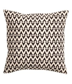 Anthracite gray/natural white. Cushion cover in cotton with jacquard-weave pattern at front, solid-color back, and concealed zip.
