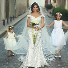 A beautiful off the shoulder wedding dress like this can be recreated for a bride of any size with any customizations needed. We are near Dallas Texas and provide custom #weddingdresses to brides all over the globe. We also make close #replicas of designer wedding dresses for less than the original. We can work from any picture you have. Get pricing at www.dariuscordell.com