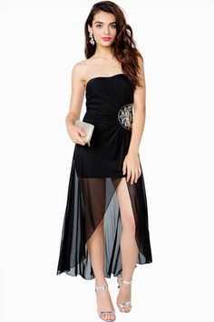 Jaws will definitely drop when you rock this stunning evening dress! Long strapless dress featuring sequined and beaded embellishments at the side. Padded sweetheart bust. Elasticized back. Front slit. Hi-low hem. Partial lining.