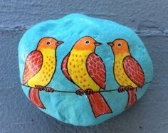 I painted this rock with acrylic paints. Its signed by me underneath and varnished.  Its just under 3 inches at its longest point (7.5 cm).  It will ship wrapped in bubble wrap inside a padded envelope.