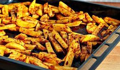 man approved spicy oven baked french fries spray or brush a baking sheet with vegetable oil generously Then place the wedges on the baking sheet Oven Baked French Fries, Diet Recipes, Cooking Recipes, Healthy Egg Breakfast, Hungarian Recipes, Fries In The Oven, Food 52, Yummy Snacks, Vegetable Recipes