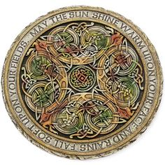 "Colorfully Celtic Stepping Stone  Etched with two lines from the famous ""Irish Blessing"", this ornately etched stepping stone may also be used to decorate a wall.  http://www.shopirish.com/Colorfully-Celtic-Stepping-Stone#"