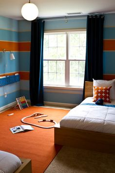 Blue/orange color scheme would work in any age boy's room