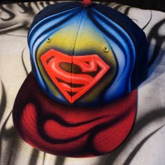 Airbrushed Superman Snapback Hat Hand Painted airbrush ($20) ❤ liked on Polyvore featuring accessories, hats, adjustable hats, snap back hats, waterproof hat, adjustable snapback hats and snapback hats