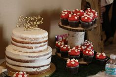 Enchanted Forest first birthday party: woodland fairy birthday cakes. Semi naked cake and toadstool cupcakes.
