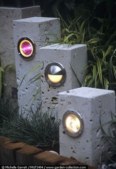 garden light columns :: I really love the mix of materials, and how the headlight (it looks like that to me) or light is surrounded by a thick chrome frame. The glass opening looks like a porthole.