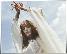 This is the singer Florence and this portrait is also from her Facebook profile. I like this photo because I think of the word freedom then I look at this. She has this beautiful white dress and reach up her arms into the sky. I also like the light settings.