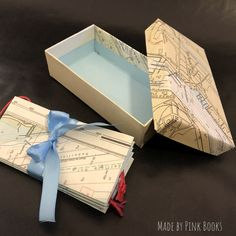 """Following #HediKyle 's instructions in her book #ArtoftheFold I made up this #nautical #pocketaccordion card, including some #gifttags. And after discovering (and being able to follow 🤪) @raffaelededominicis and @christyj1977 tutorials of #boxmaking on youtube I worked out my first """"real"""" box made of cardboard covered with #nauticalcharts which I was kindly given by a #seapilot. Maybe a nice #stationary #giftset for #easter.... #boxmaking #schachtelbau #scatolefatteamano #lotse #brunsbüttel"""