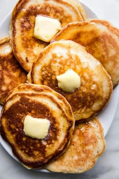 Fluffy, tender and hot off the griddle, there's nothing like waking up to a butter-topped stack of homemade buttermilk pancakes.