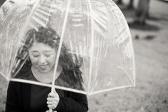 black and white senior pictures with clear umbrella in the rain, Houston-based photography: portrait, seniors, family www.gildedsun.com