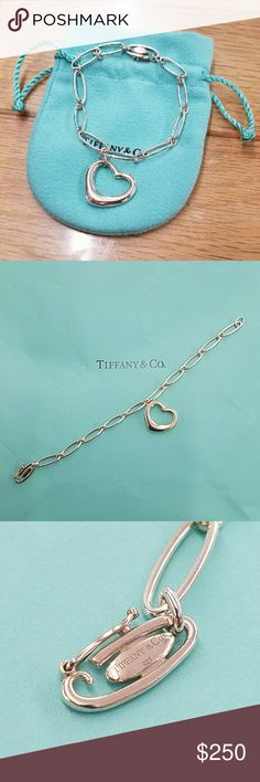 """Tiffany & Co Elsa Peretti Open Heart Bracelet Retired oval link bracelet with a medium size open heart. The open heart charm measures approximately 7/8"""" and the bracelet measures 7"""". This piece has been recently cleaned and polished by the local Tiffany store and will come as pictured with signature blue storage pouch. No box. Tiffany & Co. Jewelry Bracelets"""