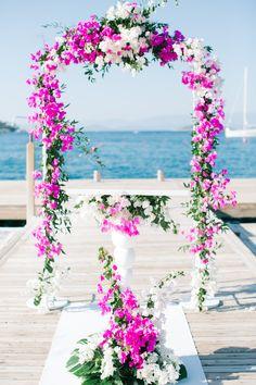 Image by Yeliz Atici Photography - Carolina Herrera Lace Bridal Gown | White & Gold Turkey Destination Wedding | Fuchsia Pink Flowers | Neutral Bridesmaid Dresses | Yeliz Atici Photography | http://www.rockmywedding.co.uk/prue-oner/
