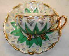 ANTIQUE MADE IN JAPAN 3 FOOTED GREEN STAR TEA CUP AND SAUCER