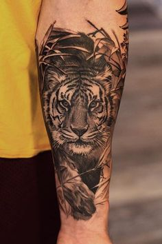 tattoo Tiger Tattoo by Jake from Ohio-Everlast Tattoo Co. - Mentor OH -- More at: olio. Tiger Tattoo Thigh, Tiger Tattoo Sleeve, Big Cat Tattoo, Lion Tattoo Sleeves, Sleeve Tattoos, Tattoo Forearm, Lion Head Tattoos, Wolf Tattoos, Feather Tattoos