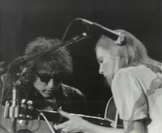 Yesterday, the folk world was rocked by Joni Mitchell. Apparently she has a giant grudge against Bob Dylan and, as Matt Diehl found out when interviewing Mitchell for the LA Times , she does not like being compared to him. Bob Dylan, Free Man In Paris, Face Off, She Song, Music Icon, Jimi Hendrix, John Lennon, Rolling Stones, The Beatles