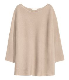 Light beige. Straight-cut sweater in a soft, rib knit with wool content…