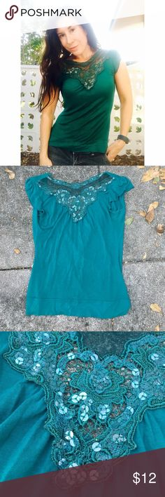Small jersey top w/ embellished sequins & embroide Small jersey top w/ embellished sequins & embroidery.  Kind of has a drop cross open back sexy as shown in last pic. Tops
