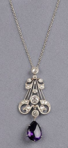 Art Deco Amethyst and Diamond Pendant, set with old European-cut diamond melee approx. total wt. 0.95 cts., suspending a pear-shaped buff-top amethyst measuring approx. 13.50 x 9.80 x 6.70 mm, suspended from a trace link chain, millegrain accents, lg. 2, 19 in. (=)