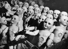 Talking dolls waiting around in a doll factory in France, 1930