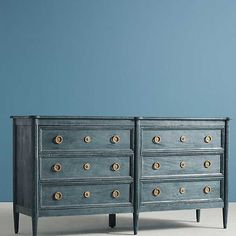 A weathered finish and key-hole hardware give this smooth, hardwood dresser a rustic yet refined look. Dresser Furniture, Wood, Dresser, Modern French Country, Six Drawer Dresser, Drawers, Diy Furniture, Dresser Drawers, Furniture Design